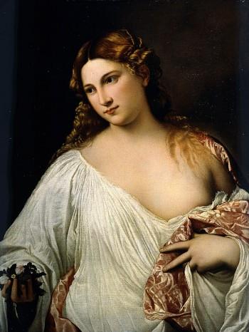 Flora, Tiziano.La giovane donna bionda in camicia potrebbe essere Madonna Valiera de La Venexiana, la nobildonna maritata.